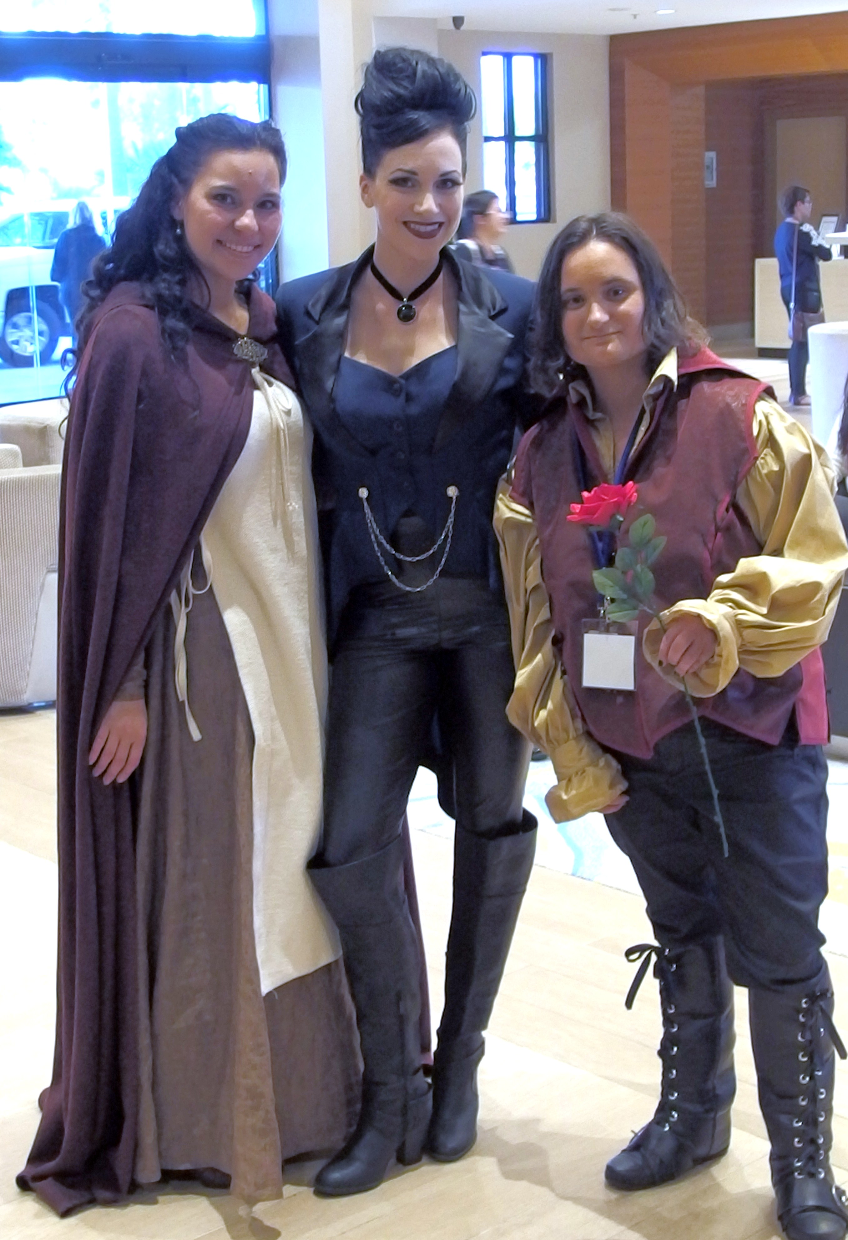 Marian, the Evil Queen and Rumpelstiltskin Cosplayers at Regal Con