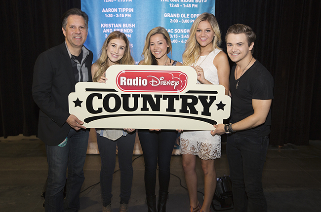 RADIO DISNEY - Radio Disney's Vice President, Programming and General Manager, Phil Guerini, was joined by some of country music's youngest rising stars Maddie & Tae (Dot Records), Kelsea Ballerini (Black River Entertainment) and Hunter Hayes (Atlantic Records) to help announce Radio Disney Country at CMA Fest on Friday, June 12. The modern, multi-platform country music-focused network for families launches this fall. (Disney Channel/Chris Hollo) PHIL GUERINI (VP, PROGRAMMING AND GENERAL MANAGER, RADIO DISNEY), MADDIE & TEA, KELSEA BALLERINI, HUNTER HAYES