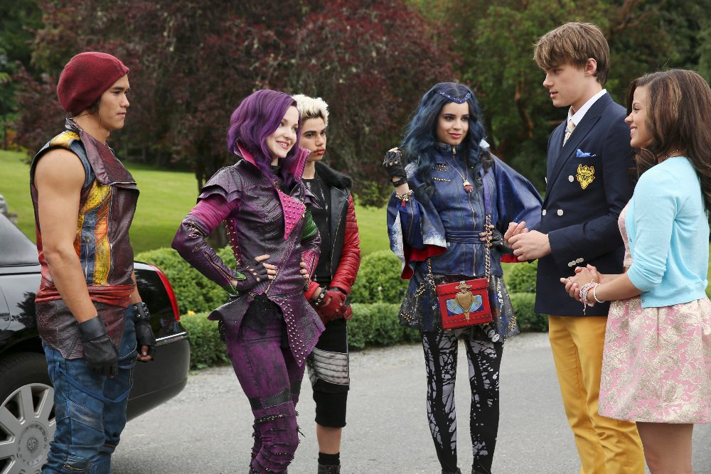 """DESCENDANTS - The teenage sons and daughters of Disney's most infamous villains star in Disney's """"Descendants,"""" a live-action movie that - with a knowing wink at traditional fairy tales -  fuses castles with classrooms to create a contemporary, music-driven story about the challenges in living up to parental and peer expectations. Made for kids, tweens and families, the movie premieres FRIDAY, JULY 31 (8:00 p.m., ET/PT) on Disney Channel and Friday, July 24 to verified users on the WATCH Disney Channel app and WATCHDisneyChannel.com. (Disney Channel/Jack Rowand) BOOBOO STEWART, DOVE CAMERON, CAMERON BOYCE, SOFIA CARSON, MITCHELL HOPE, SARAH JEFFERY"""