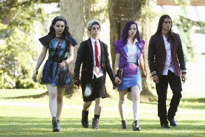 """DESCENDANTS - The teenage sons and daughters of Disney's most infamous villains star in Disney's """"Descendants,"""" a live-action movie that - with a knowing wink at traditional fairy tales - fuses castles with classrooms to create a contemporary, music-driven story about the challenges in living up to parental and peer expectations. Made for kids, tweens and families, the movie premieres FRIDAY, JULY 31 (8:00 p.m., ET/PT) on Disney Channel and Friday, July 24 to verified users on the WATCH Disney Channel app and WATCHDisneyChannel.com. (Disney Channel/Jack Rowand) SOFIA CARSON, CAMERON BOYCE, DOVE CAMERON, BOOBOO STEWART"""