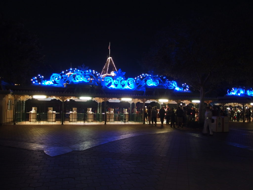 Entrance to Disneyland is aglow with holiday decorations