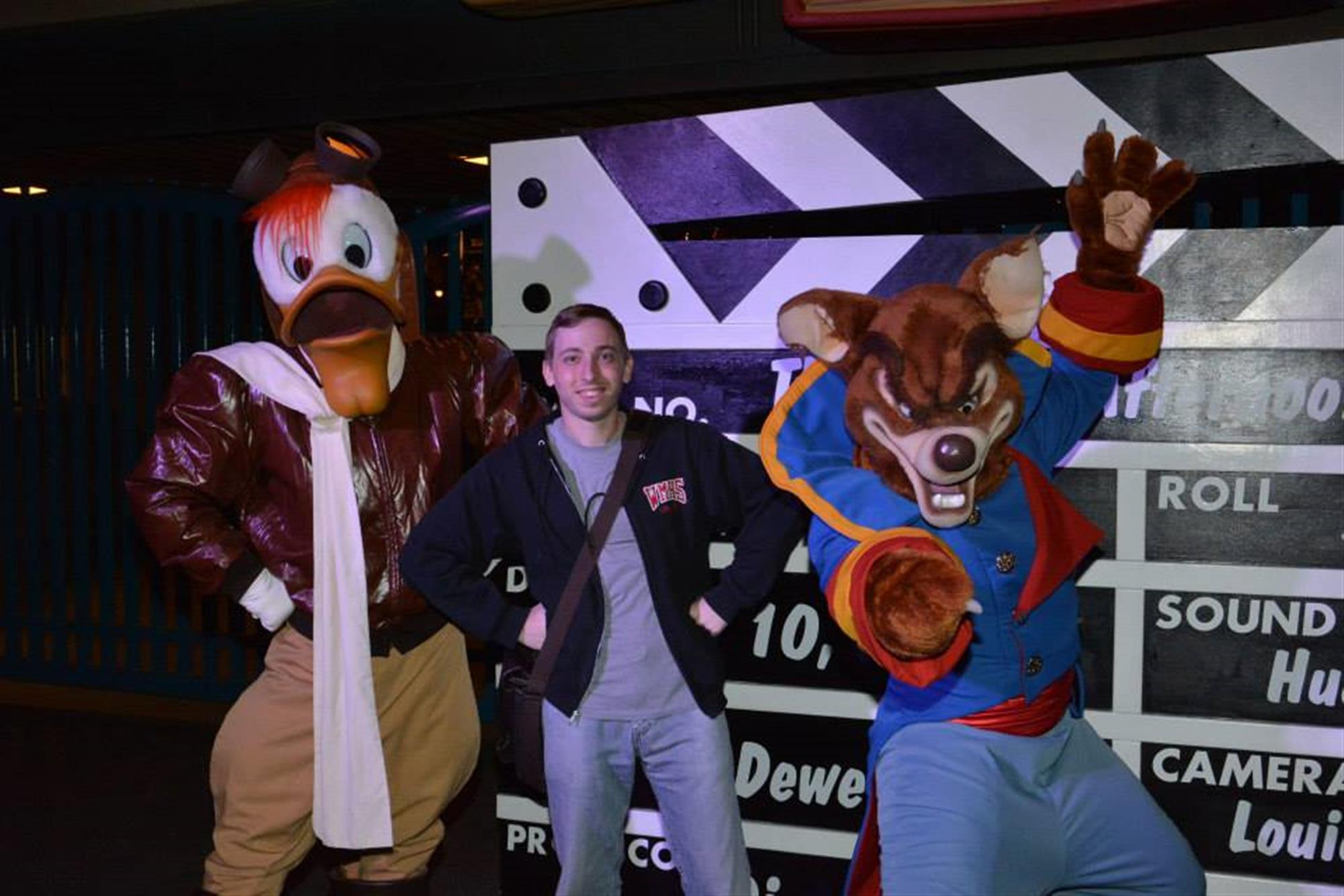 Kyle hangs with Launchpad McQuack and Don Karnage at Disneyland in 2014