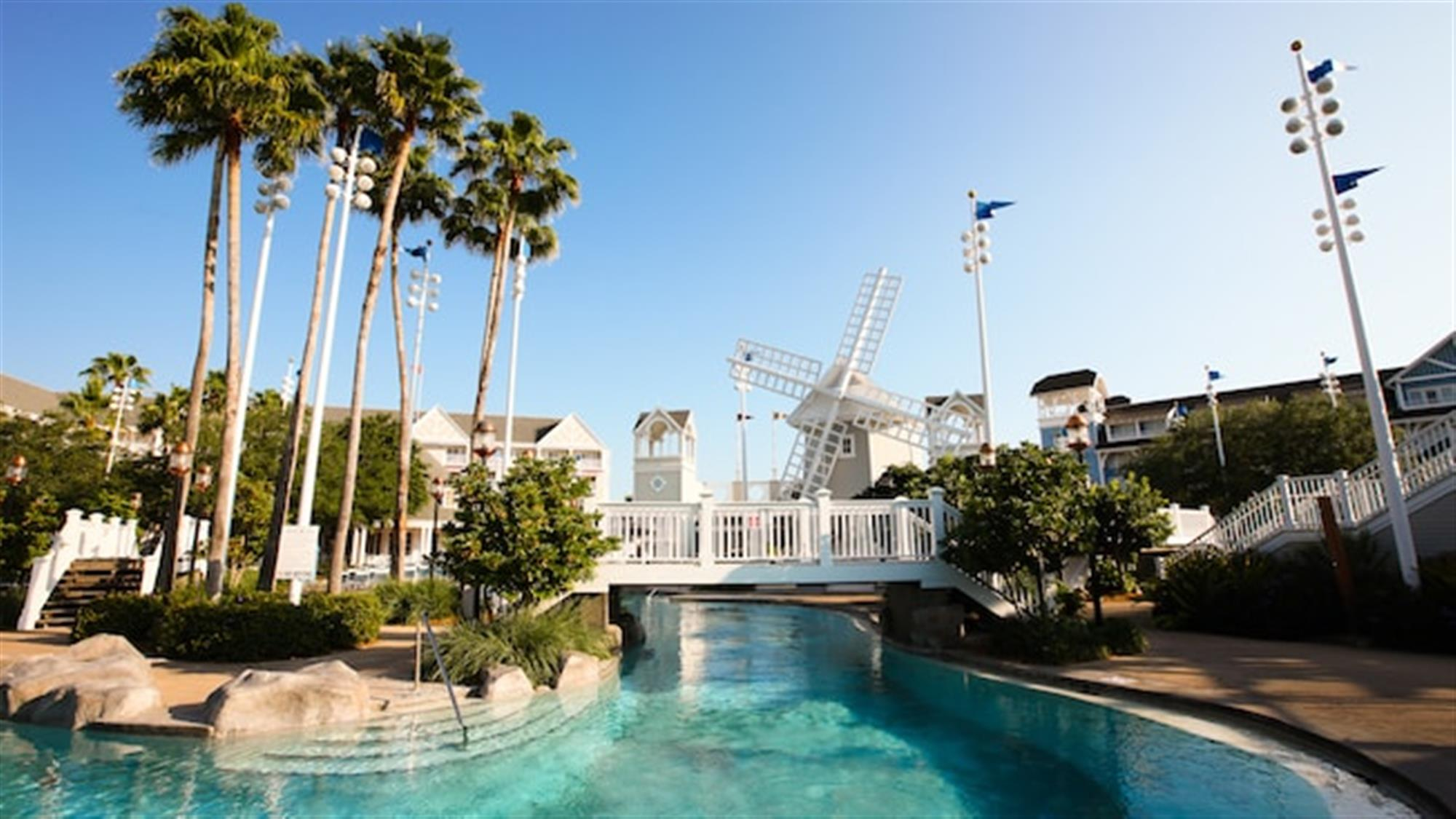 Stormalong Bay pool area featuring a windmill and an island accessible by 2 white bridges