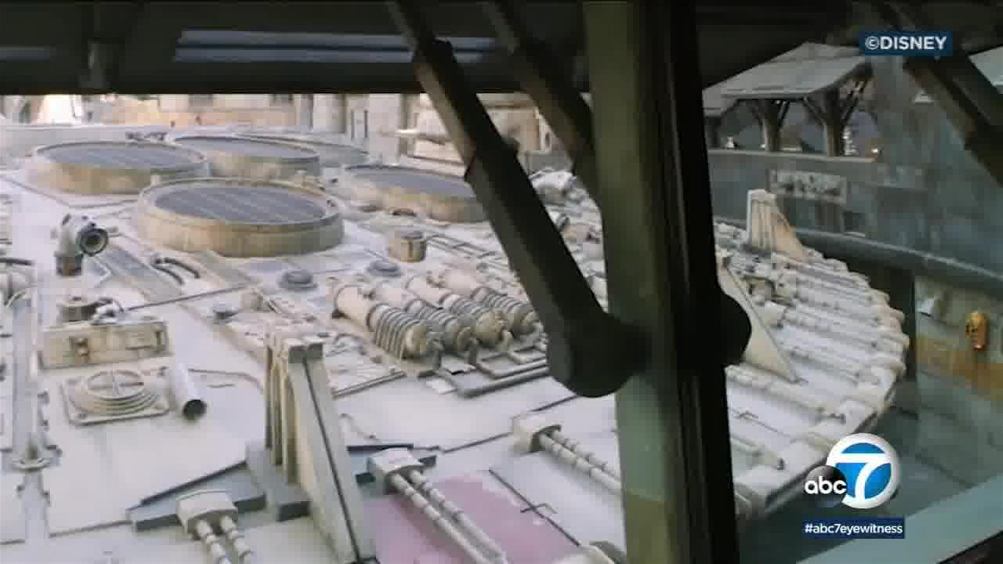 The back side of the Millennium Falcon will be visible from the Smuggler's Run queue, as guests prepare to board the ship that once belonged to Lando Calrissian, then Han Solo, then Rey.