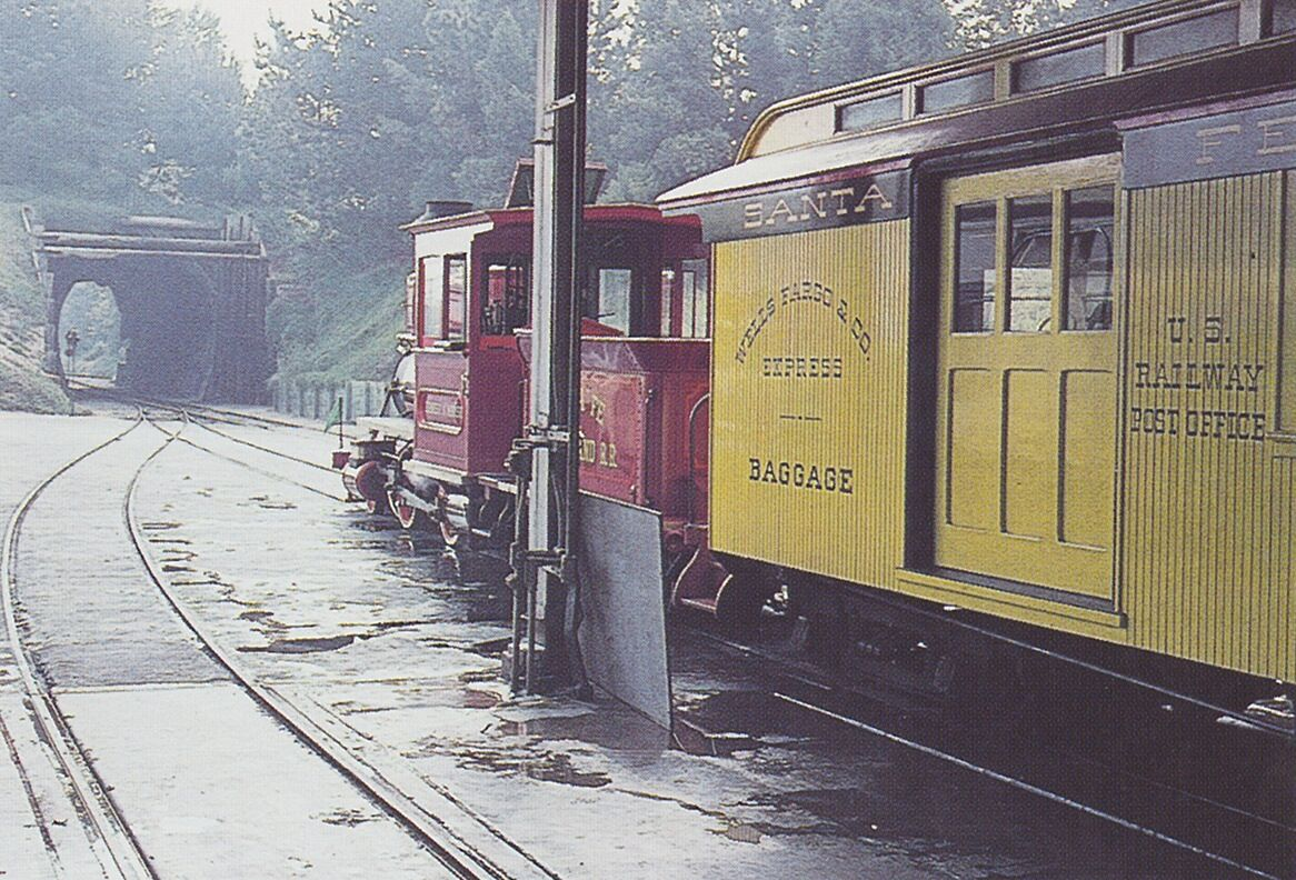 Engine #4, the Ernest S. Marsh, prepares to enter the main line through the tunnel to the east.