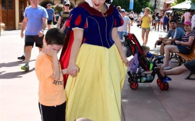Child Who is Autistic Comforted by Snow White During Epcot Visit