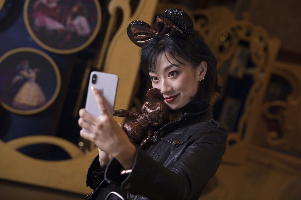 """Actress Gloria Guo (""""Belle"""" in the production) sporting the headwear in the lobby of the Grand Theatre"""