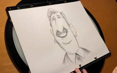 Disney Animator Draws a Caricature of Walt Disney During the Annual Caricature Show