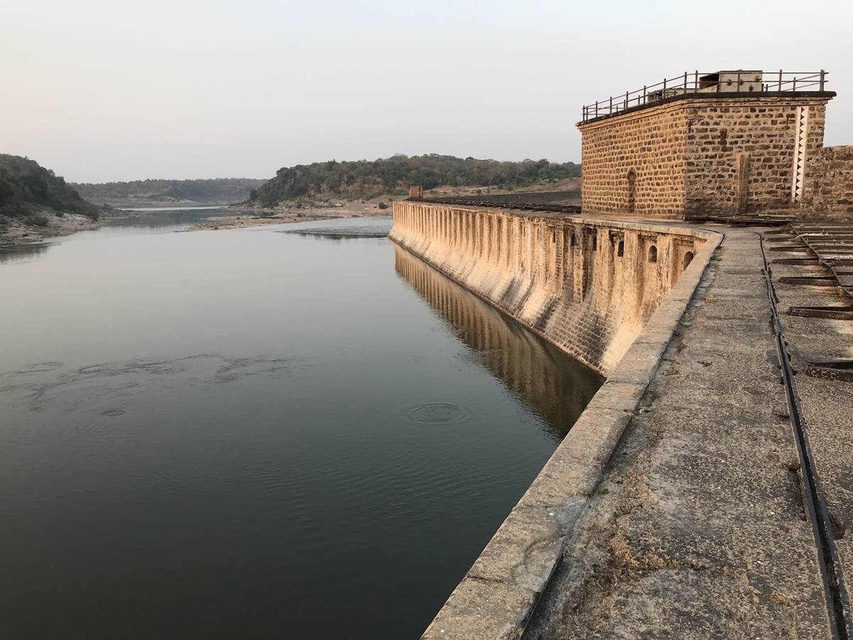 """Photo Source: National Geographic. """"Bariyapur dam, on the River Ken, has been in place for a century. A much larger dam and reservoir proposed near the site will flood 23 square miles of land, including endangered tiger habitat."""""""