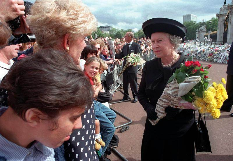 Queen Elizabeth II accepts flowers from mourners after Diana, Princess of Wales' death. September 5, 1997. (Adrian Dennis/AP/REX/Shutterstock)